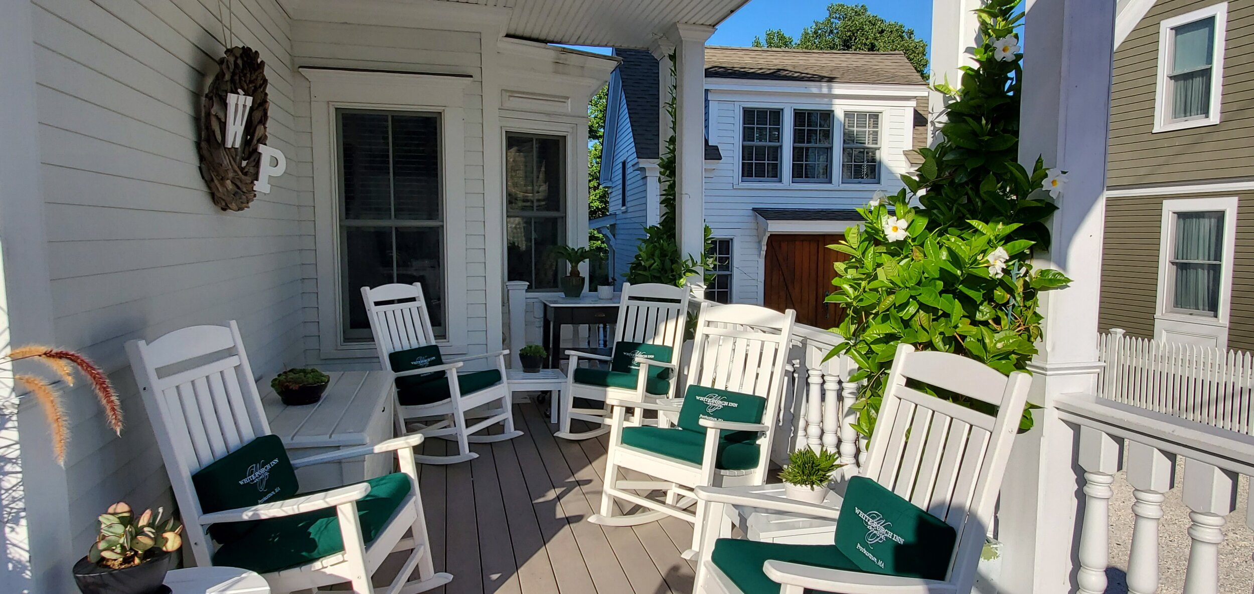 Relax on the porch of our Ptown hotel